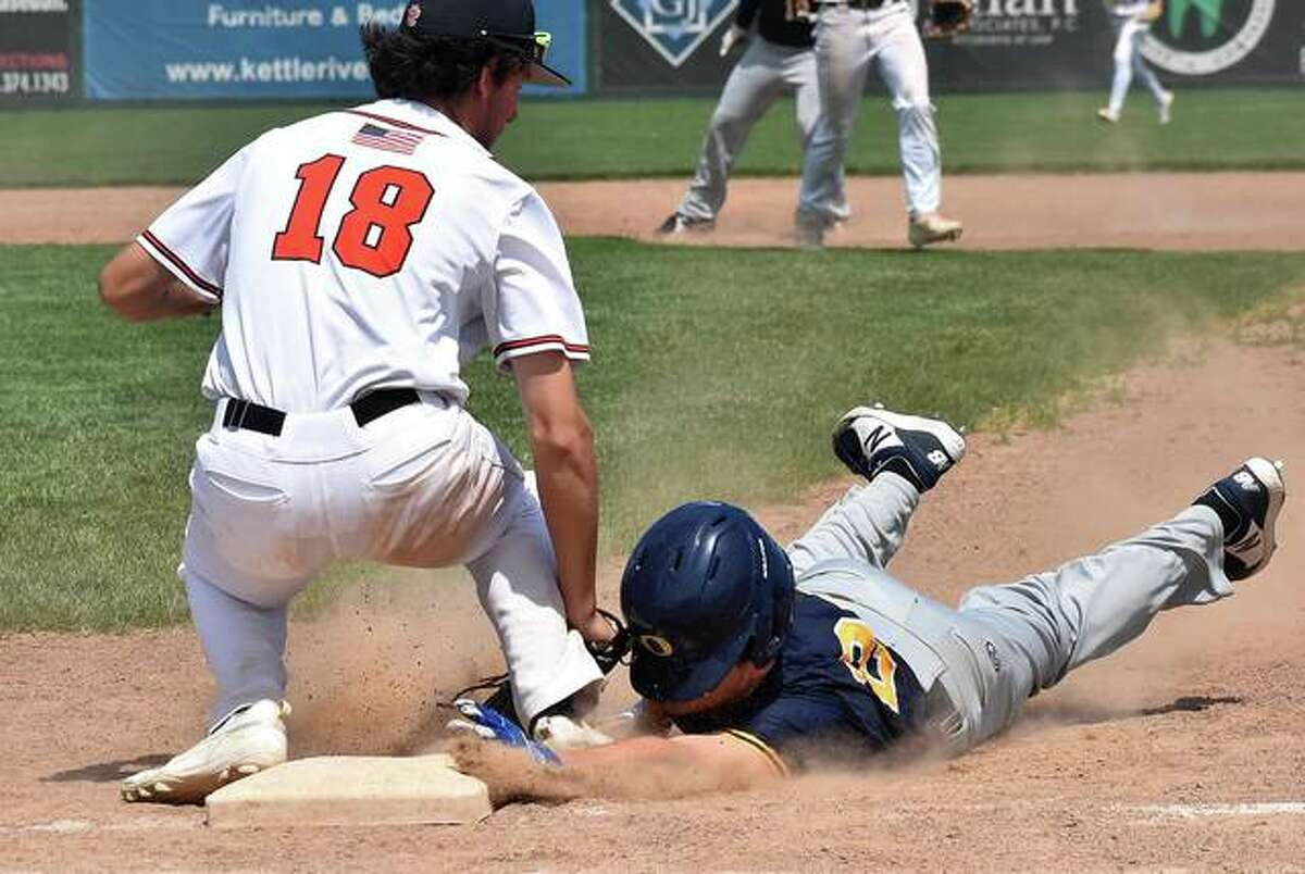 Edwardsville first baseman Riley Iffrig applies the tag in time for a pickoff in the fifth inning.