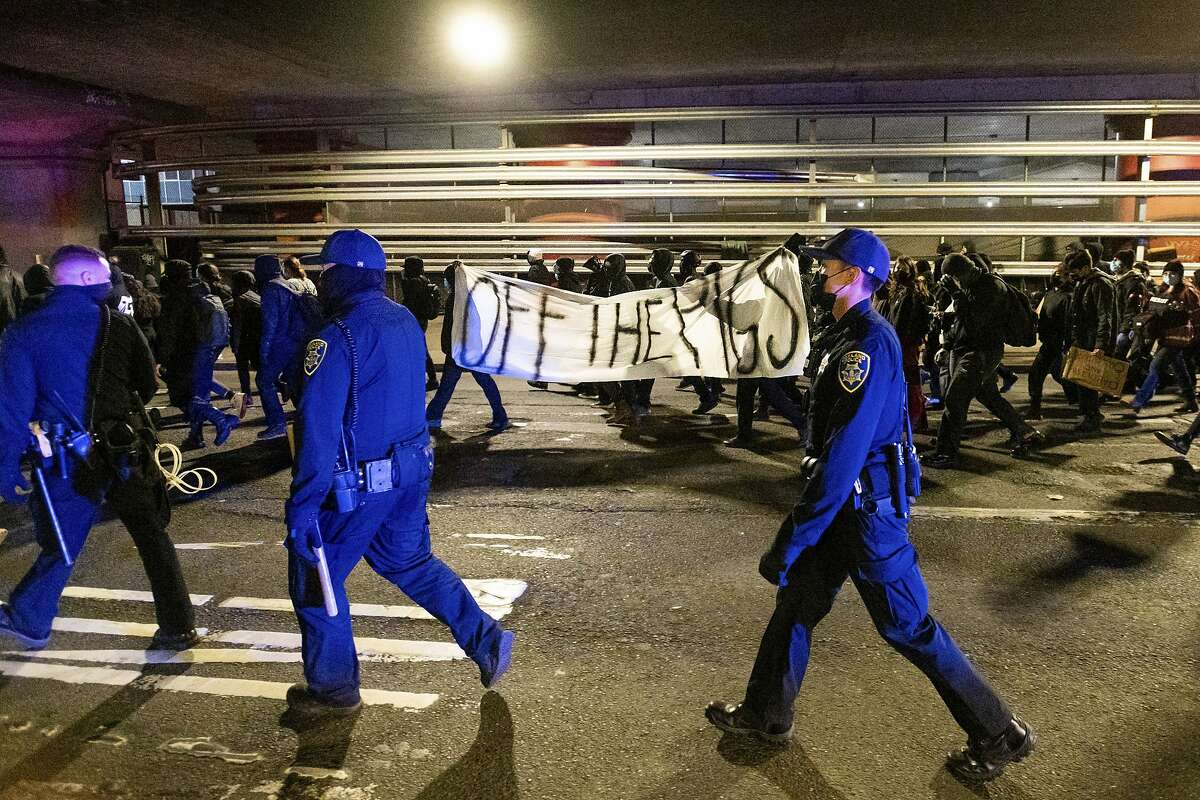 Anti-police demonstrators march through Oakland.
