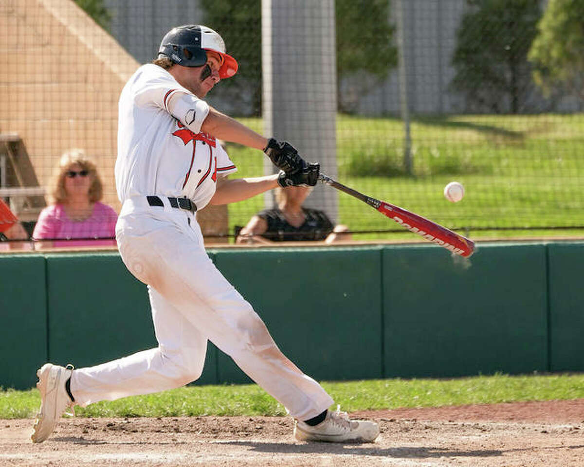 Edwardsville first baseman Riley Iffrig hits one of his two grand slams on Saturday against Saint Louis University High at Tom Pile Field.