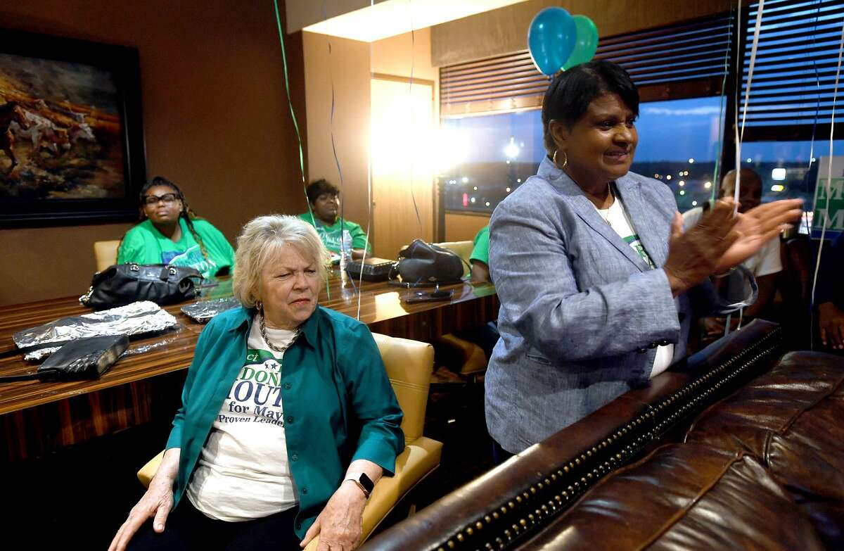 Mayoral candidate Robin Mouton reacts as poll results come in during her watch party on election day Saturday. Photo made Saturday, May 1, 2021 Kim Brent/The Enterprise
