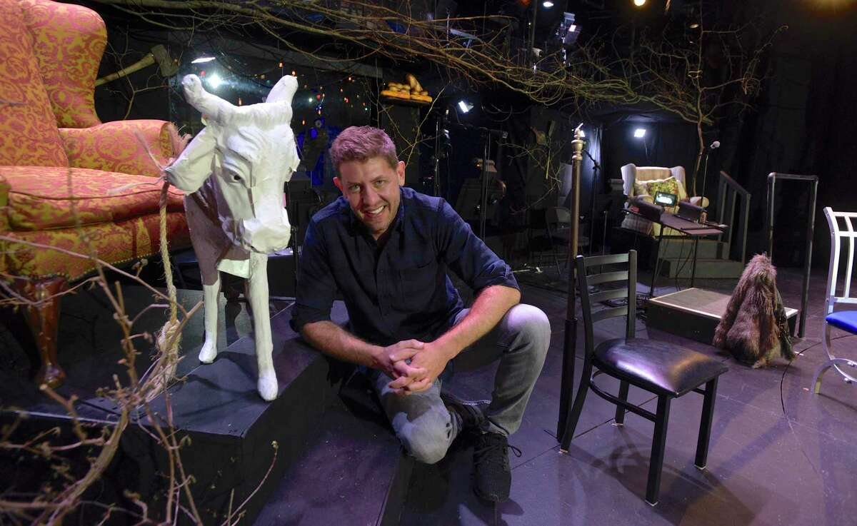 Artistic Director Daniel C. Levine poses with one of the stars of the musical, Milky White.