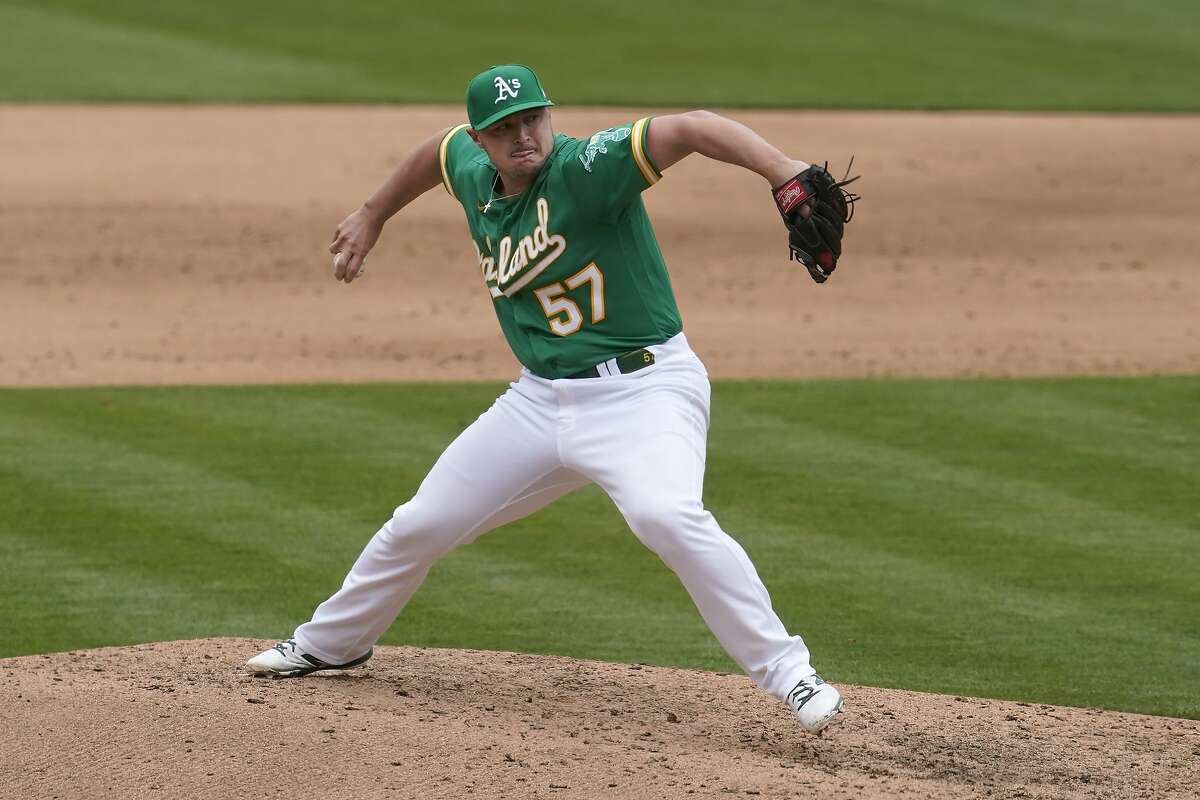 Oakland Athletics' J.B. Wendelken pitches against the Baltimore Orioles during a baseball game in Oakland, Calif., Saturday, May 1, 2021. (AP Photo/Jeff Chiu)