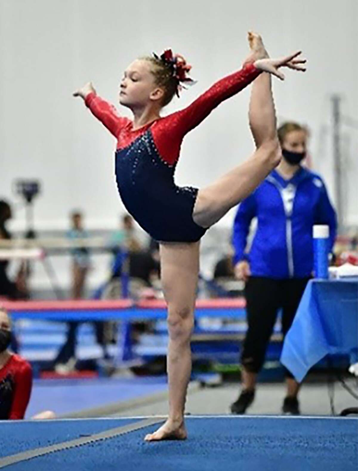 Courtney Timmeny of Darien YMCA gymnastics performs her floor routine during the Level 4-6 Connecticut State Championships, held at Farmington Valley Gymnastics in Plainville April 9-11, 2021.