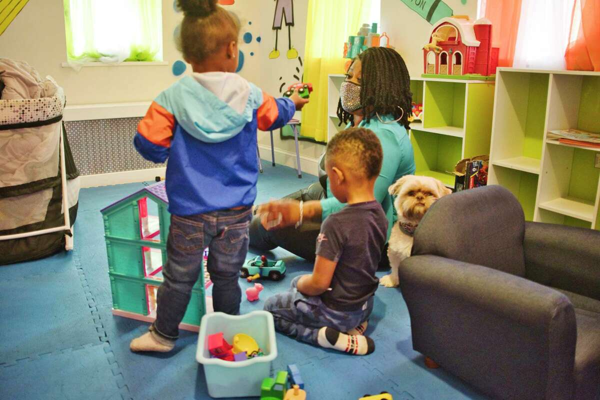 Analisa Sanchez spends time with Atreus, 2, left, and Damion, 4, at her daycare on Thursday, April 29, 2021, in Schenectady, N.Y. Sanchez started her daycare business in late August of 2020. (Paul Buckowski/Times Union)