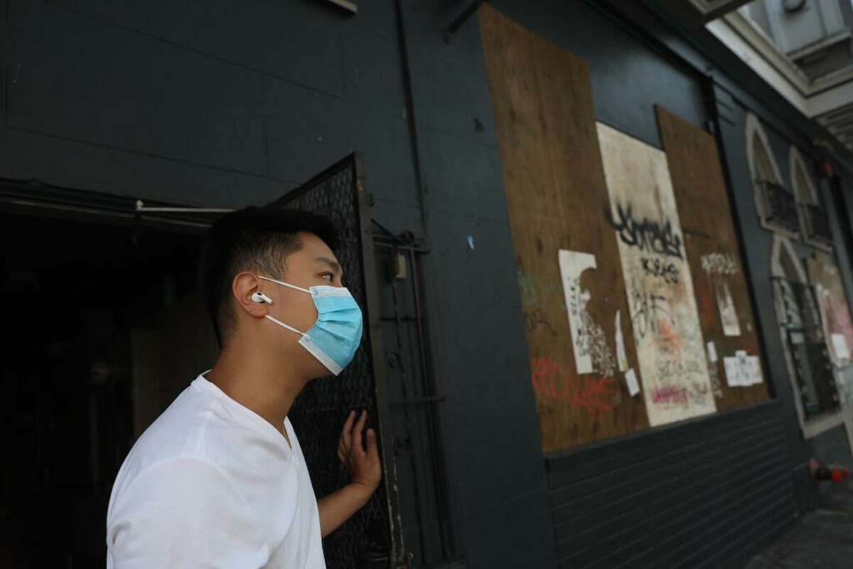 Jason Yu looks down 20th Street as he stands outside a side door to the commercial space on 20th Street that he has been trying to turn into an ice cream shop for 15 months on Wednesday, September 30, 2020 in San Francisco, Calif.