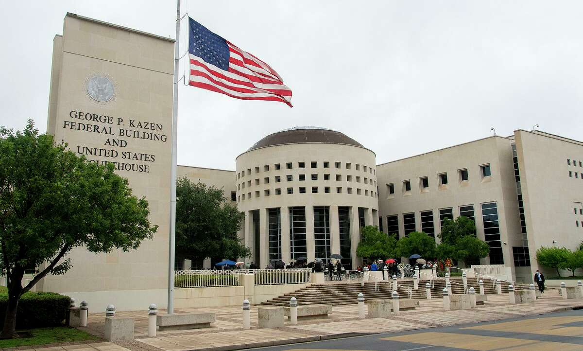 The United States flag is lowered outside the George P. Kazen Federal Building and United States Courthouse on Saturday, May 1, 2021, where the late Honorable Judge George P. Kazen lied in state during a public memorial service.