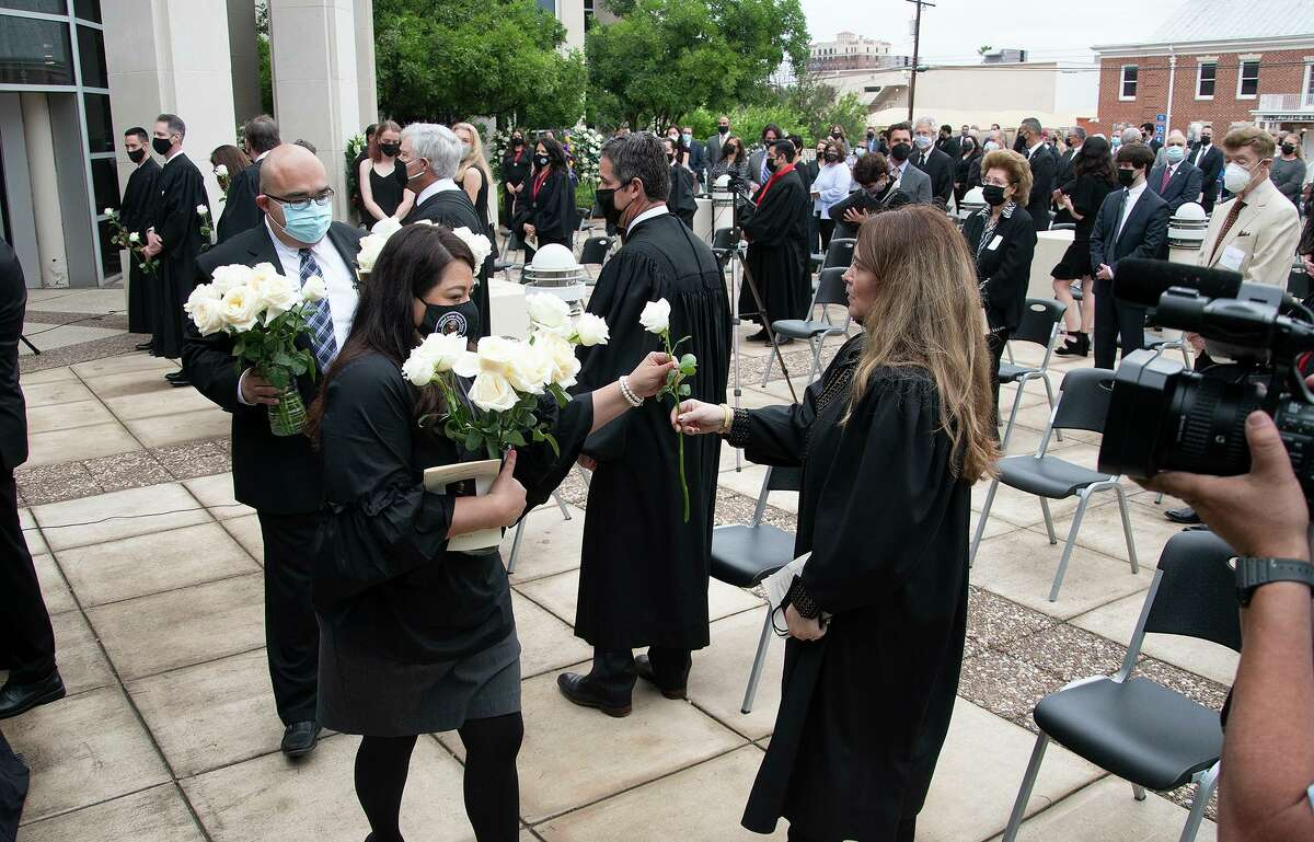 Family, friends and colleagues of the late Honorable Judge George P. Kazen attend a memorial service outside the George P. Kazen Federal Building and United States Courthouse where Judge Kazen lied in state Saturday, May 1, 2021.