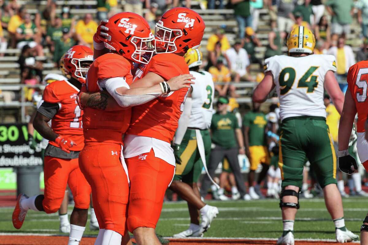 Sam Houston State quarterback Eric Schmid (3) and tight end Rowdy Godwin (85) embrace after Schmid scored the game-winning touchdown on a 6-yard run against North Dakota State during the fourth quarter of a quarterfinal game in the NCAA FCS football playoffs on Sunday, May 2, 2021, in Huntsville. Sam Houston advanced to the semifinals with a 24-20 win.