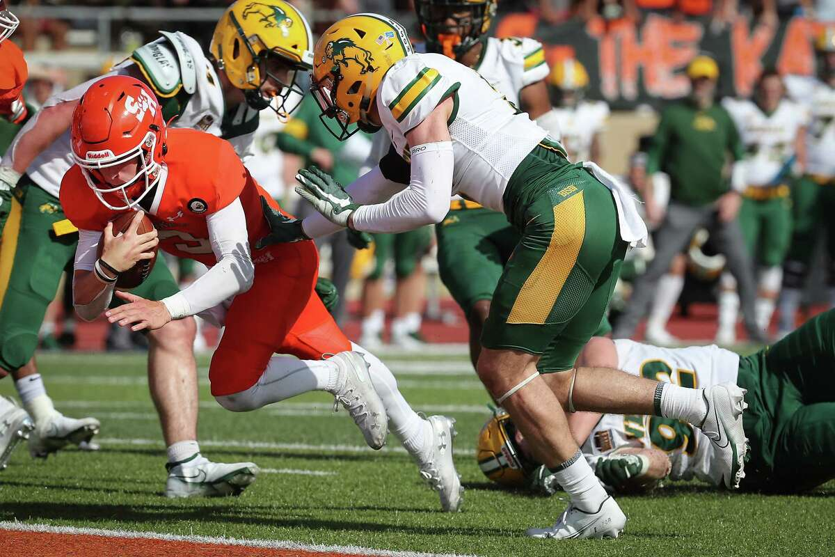 Sam Houston State quarterback Eric Schmid (3) dives into the end zone past North Dakota State safety Dawson Weber (2) for a 6-yard touchdown run during the fourth quarter of a quarterfinal game in the NCAA FCS football playoffs on Sunday, May 2, 2021, in Huntsville. Sam Houston advanced to the semifinals with a 24-20 win.