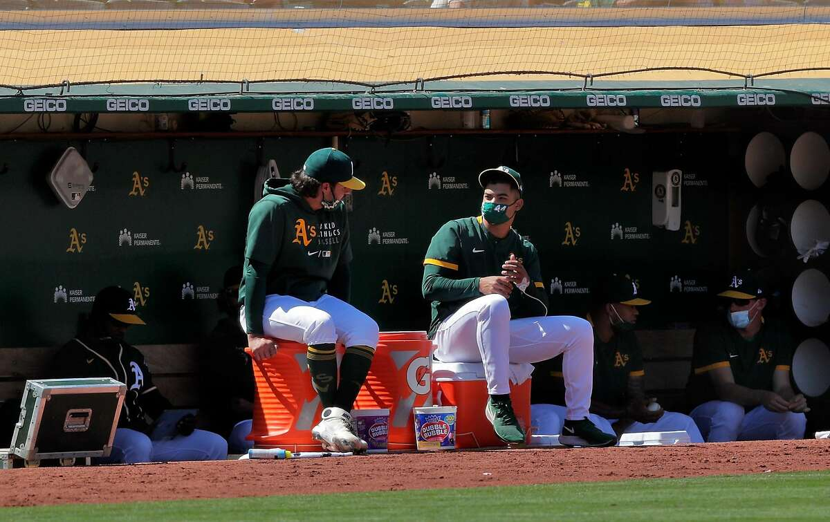 A's pitcher Jesus Luzardo (right) had his left pinkie bandaged after breaking it playing a video game before Saturday's start.