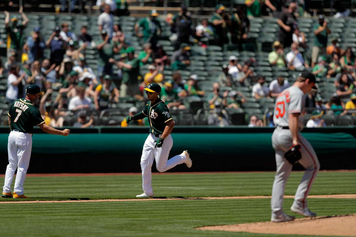 Matt Olson (28) rounds the bases after hitting a two-run homerun in the third inning as the Oakland Athletics played the Baltimore Orioles at the Coliseum in Oakland, Calif., on Sunday, May 2, 2021.
