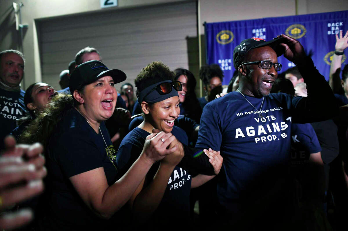 People celebrate the defeat of Proposition B, which would have stripped the police union of its ability to collectively bargain with the city, at Blue Cares, the nonprofit community outreach arm of the San Antonio Police Officers Association.