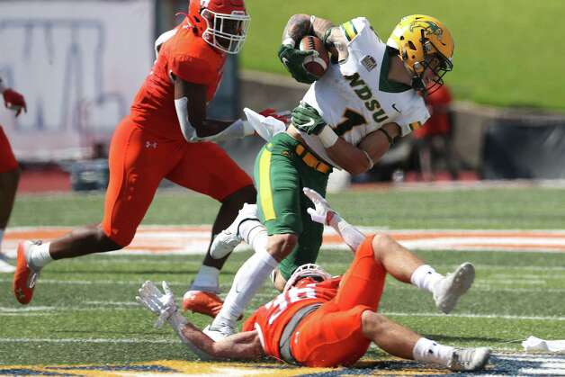 North Dakota State wide receiver Christian Watson (1) is tripped up for a loss by Sam Houston State defensive back Braiden Clopton (36) during the third quarter of a quarterfinal game in the NCAA FCS football playoffs on Sunday, May 2, 2021, in Huntsville. Sam Houston advanced to the semifinals with a 24-20 win. Photo: Brett Coomer, Staff Photographer / © 2021 Houston Chronicle