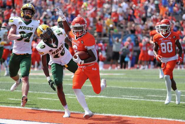 Sam Houston State running back Noah Smith (6) runs past North Dakota State safety Dom Jones (10) into the end zone for a 23-yard touchdown reception during the third quarter of a quarterfinal game in the NCAA FCS football playoffs on Sunday, May 2, 2021, in Huntsville. Sam Houston advanced to the semifinals with a 24-20 win. Photo: Brett Coomer, Staff Photographer / © 2021 Houston Chronicle