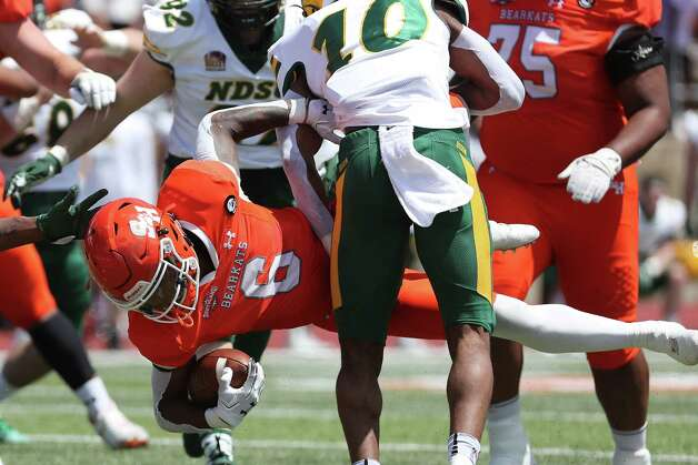 Sam Houston State running back Noah Smith (6) is stopped just short of the goal line by North Dakota State safety Dom Jones (10) during the first quarter of a quarterfinal game in the NCAA FCS football playoffs on Sunday, May 2, 2021, in Huntsville. Sam Houston advanced to the semifinals with a 24-20 win. Photo: Brett Coomer, Staff Photographer / © 2021 Houston Chronicle