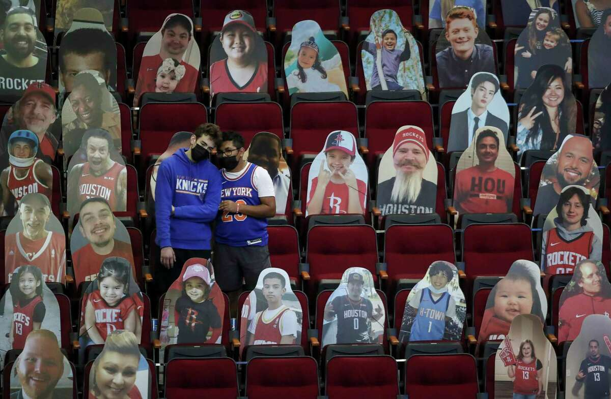 New York Knicks fans watch warmups before an NBA game between the Houston Rockets and the New York Knicks on Sunday, May 2, 2021, at the Toyota Center in Houston.