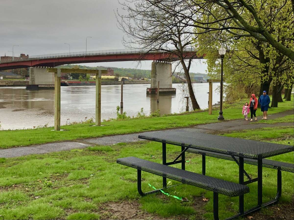 A family enjoys an afternoon stroll at Hudson Shores Park in Watervliet on Sunday, May 2, 2021. (Gary Hahn / Times Union)