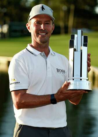 Mike Weir holds the champions' trophy after winning the Insperity Invitational golf tournament, Sunday, May 2, 2021, in The Woodlands, TX. Weir won the tournament at -10, two shots better than John Daly, Tim Pretovic and David Toms. Photo: Eric Christian Smith, Contributor
