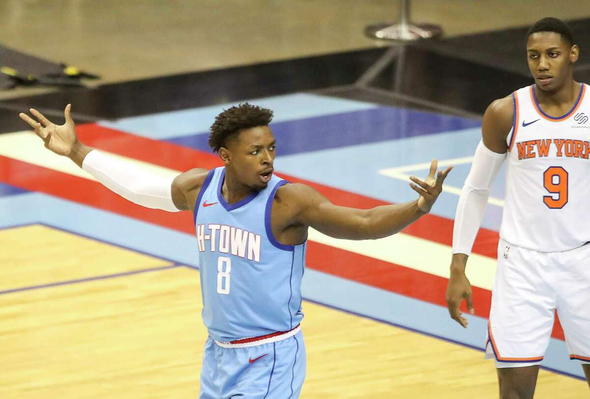 Houston Rockets forward Jae'Sean Tate (8) reacts to a call during the first quarter of an NBA game Sunday, May 2, 2021, at the Toyota Center in Houston.