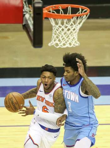New York Knicks guard Elfrid Payton (6) drives to the basket while defended by Houston Rockets guard Kevin Porter Jr. (3) during the first quarter of an NBA game Sunday, May 2, 2021, at the Toyota Center in Houston. Photo: Jon Shapley, Staff Photographer / © 2021 Houston Chronicle