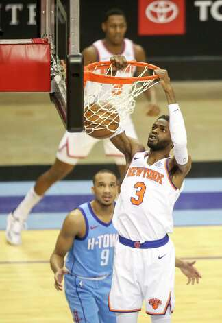 New York Knicks center Nerlens Noel (3) dunks the ball as Houston Rockets guard Avery Bradley (9) watches during the first quarter of an NBA game Sunday, May 2, 2021, at the Toyota Center in Houston. Photo: Jon Shapley, Staff Photographer / © 2021 Houston Chronicle