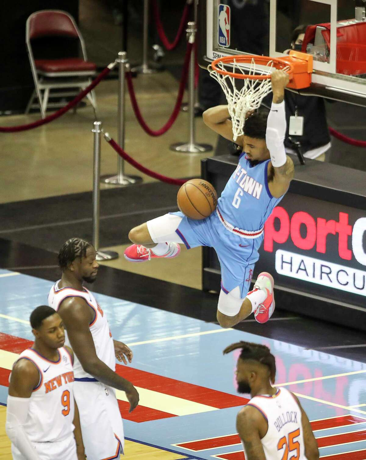 Houston Rockets forward Kenyon Martin Jr. (6) dunks the ball as New York Knicks guard RJ Barrett (9), forward Julius Randle (30) and forward Reggie Bullock (25) defend during the first quarter of an NBA game Sunday, May 2, 2021, at the Toyota Center in Houston.