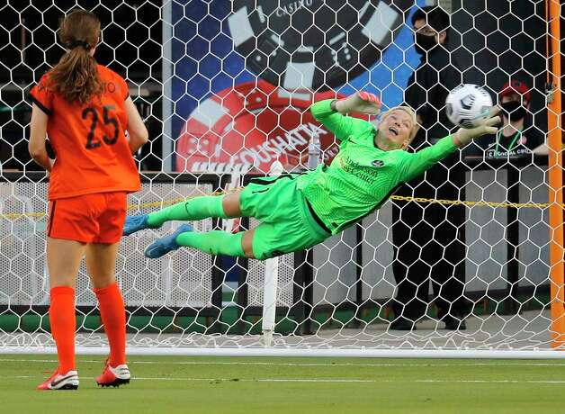 HOUSTON, TX - MAY 2: Houston Dash goalkeeper Jane Campbell (1) makes a save against the Portland Thorns FC in the first half during a women's soccer game at BBVA Stadium May 2, 2021 in Houston, Texas. (Photo by Bob Levey/Contributor) Photo: Bob Levey, Houston Chronicle / 2021 Bob Levey