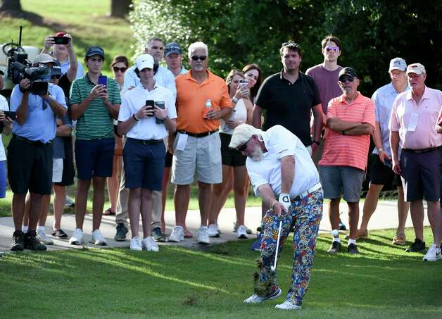 John Daly hits his second shot on No. 17 during the final round of the Insperity Invitational golf tournament, Sunday, May 2, 2021, in The Woodlands, TX. Photo: Eric Christian Smith, Contributor