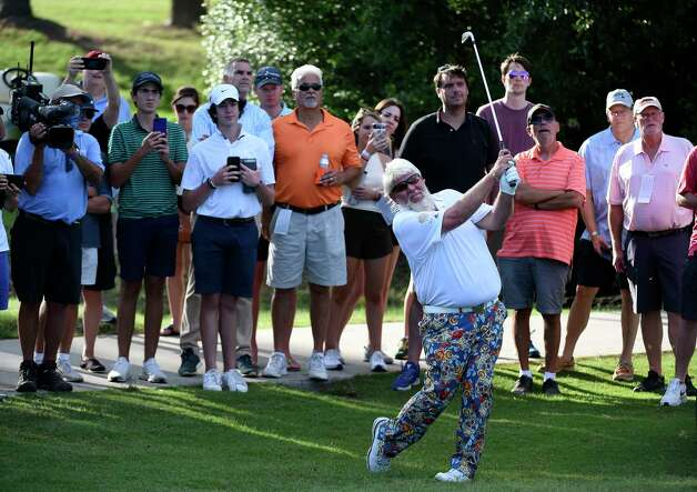 John Daly follows through on his second shot on No. 17 during the final round of the Insperity Invitational golf tournament, Sunday, May 2, 2021, in The Woodlands, TX. Photo: Eric Christian Smith, Contributor