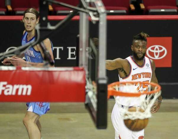 New York Knicks forward Reggie Bullock (25) and Houston Rockets forward Kelly Olynyk (41) watches his shot go in during the first quarter of an NBA game Sunday, May 2, 2021, at the Toyota Center in Houston. Photo: Jon Shapley, Staff Photographer / © 2021 Houston Chronicle