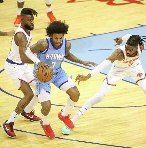 Houston Rockets guard Kevin Porter Jr. (3) is defended by New York Knicks forward Reggie Bullock (25) and center Nerlens Noel (3) during the first quarter of an NBA game Sunday, May 2, 2021, at the Toyota Center in Houston. Photo: Jon Shapley, Staff Photographer / © 2021 Houston Chronicle