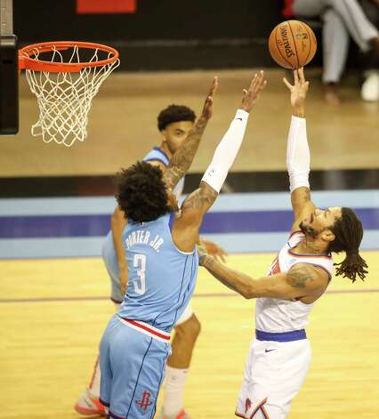 New York Knicks guard Derrick Rose (4) drives to the basket while defended by Houston Rockets guard Kevin Porter Jr. (3) during the first quarter of an NBA game Sunday, May 2, 2021, at the Toyota Center in Houston. Photo: Jon Shapley, Staff Photographer / © 2021 Houston Chronicle