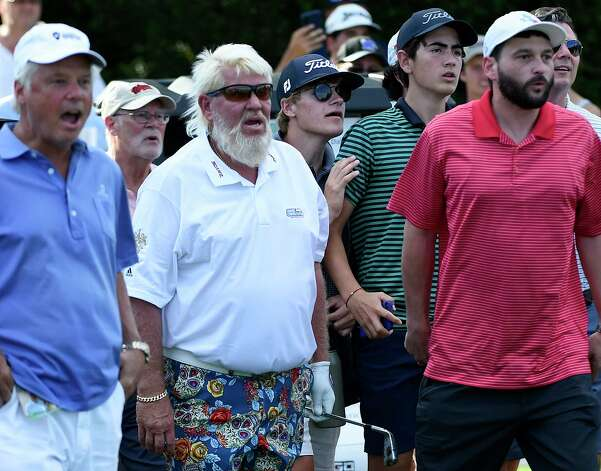 John Daly, second from left, watches his second shot on No. 17 with the gallery during the final round of the Insperity Invitational golf tournament, Sunday, May 2, 2021, in The Woodlands, TX. Photo: Eric Christian Smith, Contributor