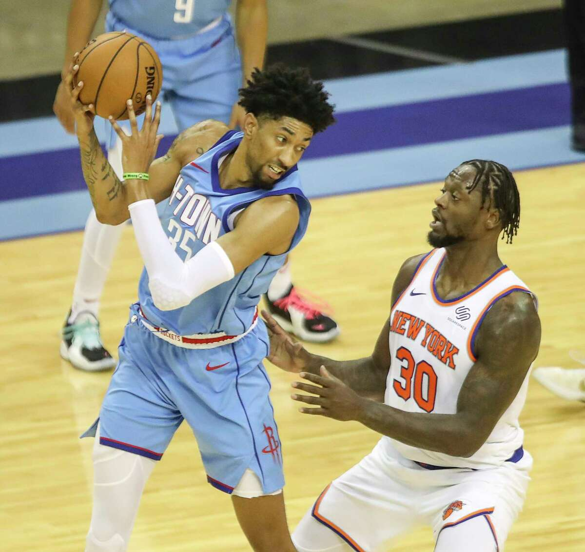 Rockets center Christian Wood finished fourth in the NBA's Most Improved Player balloting behind the Knicks' Julius Randle (right), the runaway winner.