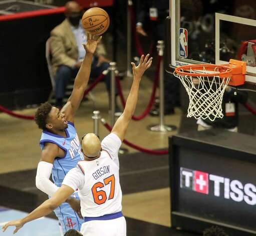 Houston Rockets forward Jae'Sean Tate (8) drives to the basket while defended by New York Knicks center Taj Gibson (67) during the second quarter of an NBA game Sunday, May 2, 2021, at the Toyota Center in Houston. Photo: Jon Shapley, Staff Photographer / © 2021 Houston Chronicle