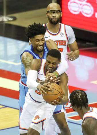 Houston Rockets center Christian Wood (35) fouls New York Knicks guard RJ Barrett (9) as center Taj Gibson (67) watches during the second quarter of an NBA game Sunday, May 2, 2021, at the Toyota Center in Houston. Photo: Jon Shapley, Staff Photographer / © 2021 Houston Chronicle