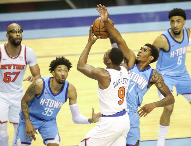 New York Knicks guard RJ Barrett (9) drives to the basket while defended by Houston Rockets center Christian Wood (35) and guard Armoni Brooks (7) during the second quarter of an NBA game Sunday, May 2, 2021, at the Toyota Center in Houston. Photo: Jon Shapley, Staff Photographer / © 2021 Houston Chronicle