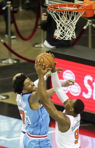 Houston Rockets center Christian Wood (35) and New York Knicks guard RJ Barrett (9) go after a rebound during the second quarter of an NBA game Sunday, May 2, 2021, at the Toyota Center in Houston. Photo: Jon Shapley, Staff Photographer / © 2021 Houston Chronicle