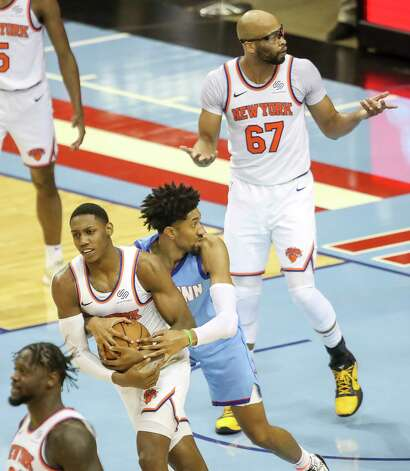 New York Knicks center Taj Gibson (67) reacts to a foul call as Houston Rockets center Christian Wood (35) fouls New York Knicks guard RJ Barrett (9) during the second quarter of an NBA game Sunday, May 2, 2021, at the Toyota Center in Houston. Photo: Jon Shapley, Staff Photographer / © 2021 Houston Chronicle
