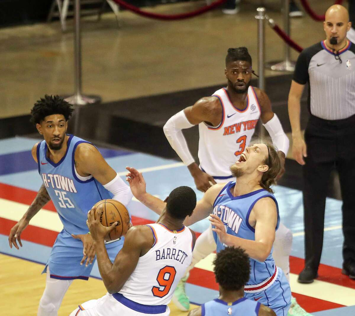 Houston Rockets forward Kelly Olynyk (41) and New York Knicks' RJ Barrett (9) each get a foul during the third quarter of an NBA game Sunday, May 2, 2021, at the Toyota Center in Houston.