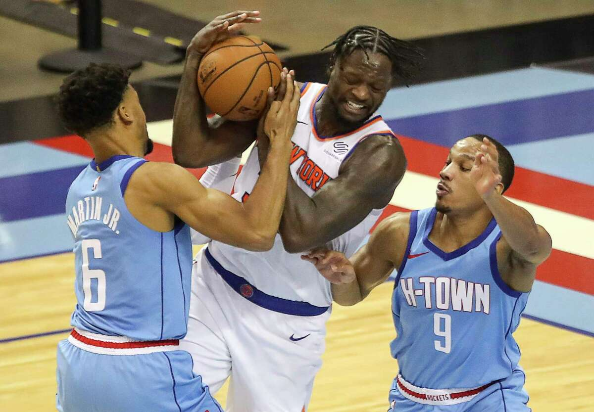 New York Knicks forward Julius Randle (30) is defended by Houston Rockets forward Kenyon Martin Jr. (6) and guard Avery Bradley (9) during the third quarter of an NBA game Sunday, May 2, 2021, at the Toyota Center in Houston.