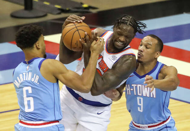 New York Knicks forward Julius Randle (30) is defended by Houston Rockets forward Kenyon Martin Jr. (6) and guard Avery Bradley (9) during the third quarter of an NBA game Sunday, May 2, 2021, at the Toyota Center in Houston. Photo: Jon Shapley, Staff Photographer / © 2021 Houston Chronicle