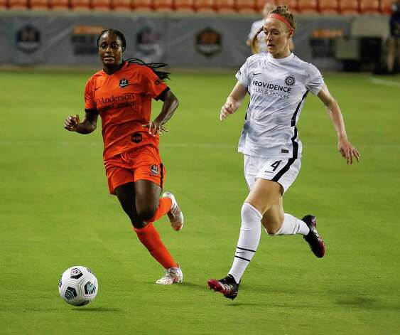 HOUSTON, TX - MAY 2: Houston Dash forward Nichelle Prince (8) runs down the ball while Portland Thorns FC defender Becky Sauerbrunn (4) defense in the second halfduring a women's soccer game at BBVA Stadium May 2, 2021 in Houston, Texas. The Dash played Portland Thorns FC to a 1-1 draw. Photo: Bob Levey, Houston Chronicle / 2021 Bob Levey