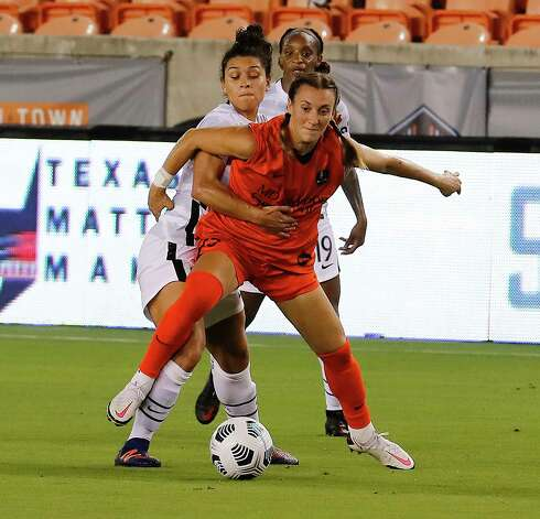 HOUSTON, TX - MAY 2: Houston Dash midfielder Gabby Seiler (5) is held by Portland Thorns FC midfielder Raquel Rodríguez (11) in the second half during a women's soccer game at BBVA Stadium May 2, 2021 in Houston, Texas. The Dash played Portland Thorns FC to a 1-1 draw. Photo: Bob Levey, Houston Chronicle / 2021 Bob Levey