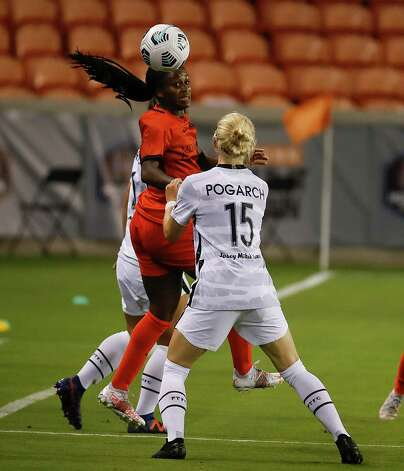 HOUSTON, TX - MAY 2: Houston Dash forward Nichelle Prince (8) heads the ball away from Portland Thorns FC defender Madison Pogarch (15) in the second half during a women's soccer game at BBVA Stadium May 2, 2021 in Houston, Texas. The Dash played Portland Thorns FC to a 1-1 draw. Photo: Bob Levey, Houston Chronicle / 2021 Bob Levey