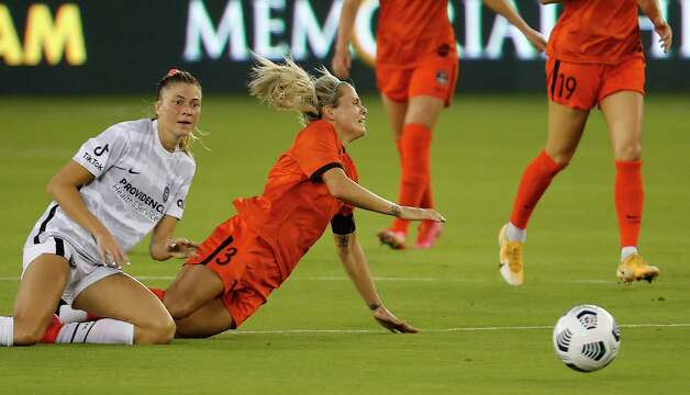 HOUSTON, TX - MAY 2: Houston Dash forward Rachel Daly (3) is tackled from behind by Portland Thorns FC defender Kelli Hubly (20) in the second half during a women's soccer game at BBVA Stadium May 2, 2021 in Houston, Texas. The Dash played Portland Thorns FC to a 1-1 draw. Photo: Bob Levey, Houston Chronicle / 2021 Bob Levey