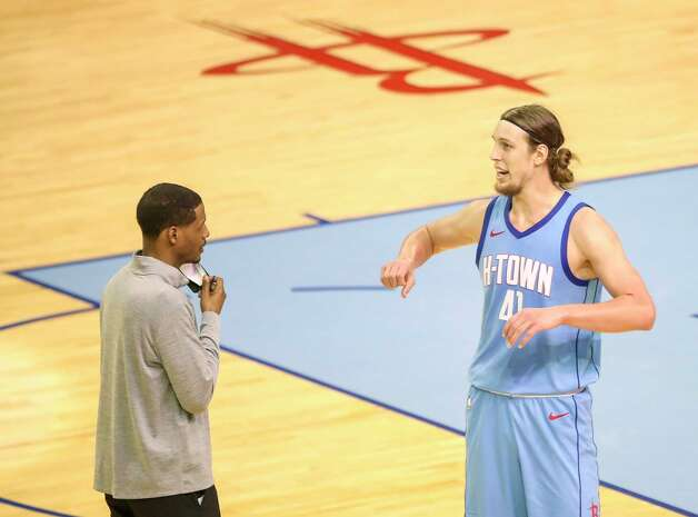 Houston Rockets forward Kelly Olynyk (41) talks to head coach Stephen Silas during the fourth quarter of an NBA game Sunday, May 2, 2021, at the Toyota Center in Houston. Photo: Jon Shapley, Staff Photographer / © 2021 Houston Chronicle