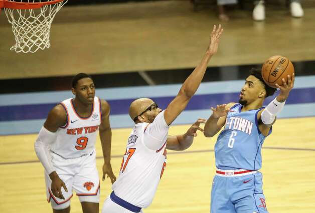 Houston Rockets forward Kenyon Martin Jr. (6) drives to the basket while defended by New York Knicks center Taj Gibson (67) a guard RJ Barrett (9) watches during the fourth quarter of an NBA game Sunday, May 2, 2021, at the Toyota Center in Houston. Photo: Jon Shapley, Staff Photographer / © 2021 Houston Chronicle