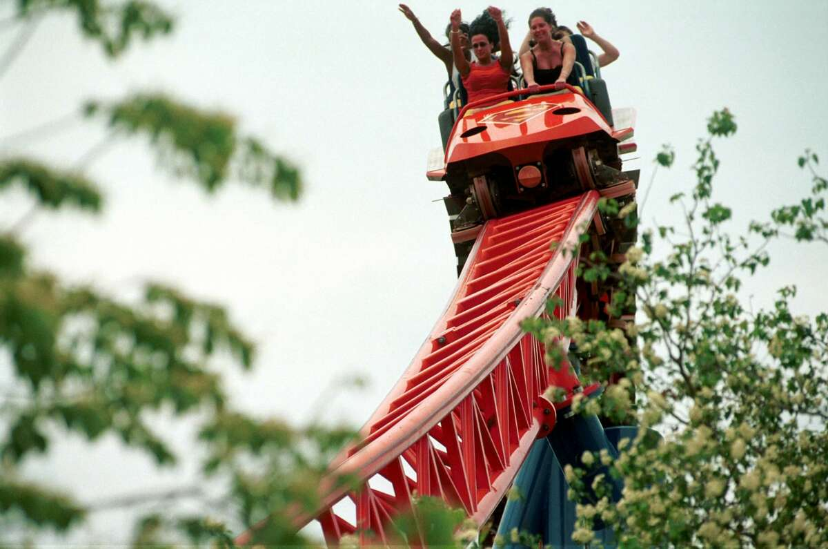 """Park goers enjoy """"Superman-Ride of Steel,"""" one of the new rides at Six Flags Amusement Park."""