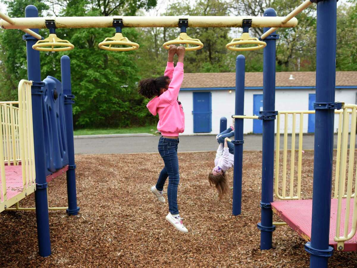 Children play on the playground during recess at Springdale Elementary School in Stamford, Conn. Thursday, April 29, 2021. Stamford schools re-opened playgrounds last month for the first time since the beginning of the pandemic.